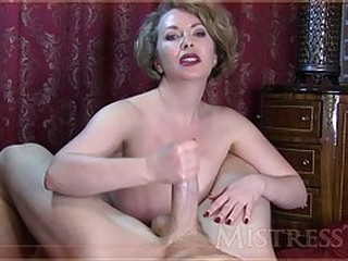 Voluptuous blonde woman with big boobs is naked and rubbing her lover's cock to please him